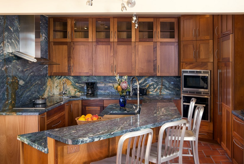 The Van Gogh granite and African mahogany cabinets vibrantly transform this ocean-side kitchen.