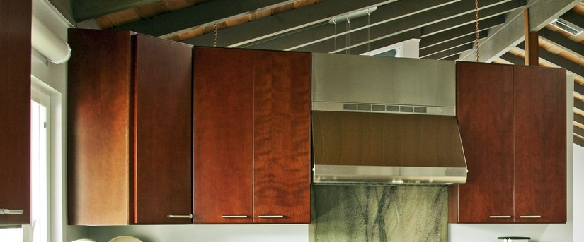High-end Dura Supreme cabinets in classic cherry provided contrast with the countertops and flooring.