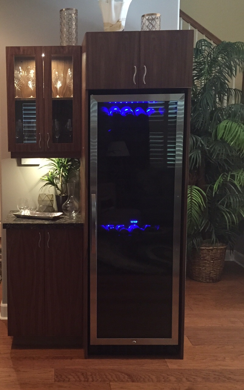 Custom cabinets designed to house a wine refrigerator and bottles of the good stuff. Click on the photo to learn more about Hawaii Kitchen & Bath.